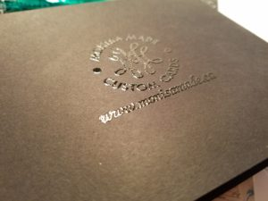 logo and website embossed in black